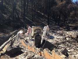 HazMat volunteer crews help Butte Fire victims sift through the remains of their homes on Wednesday, Sept. 23, 2015.