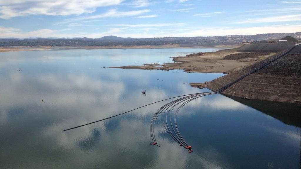 Pipes designed to pump water over Folsom Dam in case Folsom Lake water levels fall below the city's intake were connected with barges on Thursday, Sept. 24, 2015.