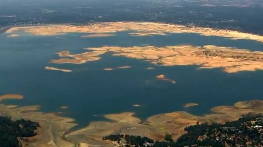 Aerial view of Folsom Lake on Friday, Sept. 18, 2015, shows low water levels and exposed parts of the lake bed.