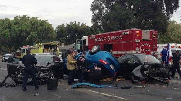 First responders work at the scene of a multi-vehicle crash in north Modesto on Wednesday, Sept. 30, 2015.