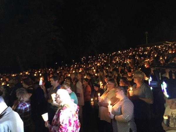 Residents gather at a Roseburg, Oregon, park for a vigil for the victims of a deadly mass shooting.