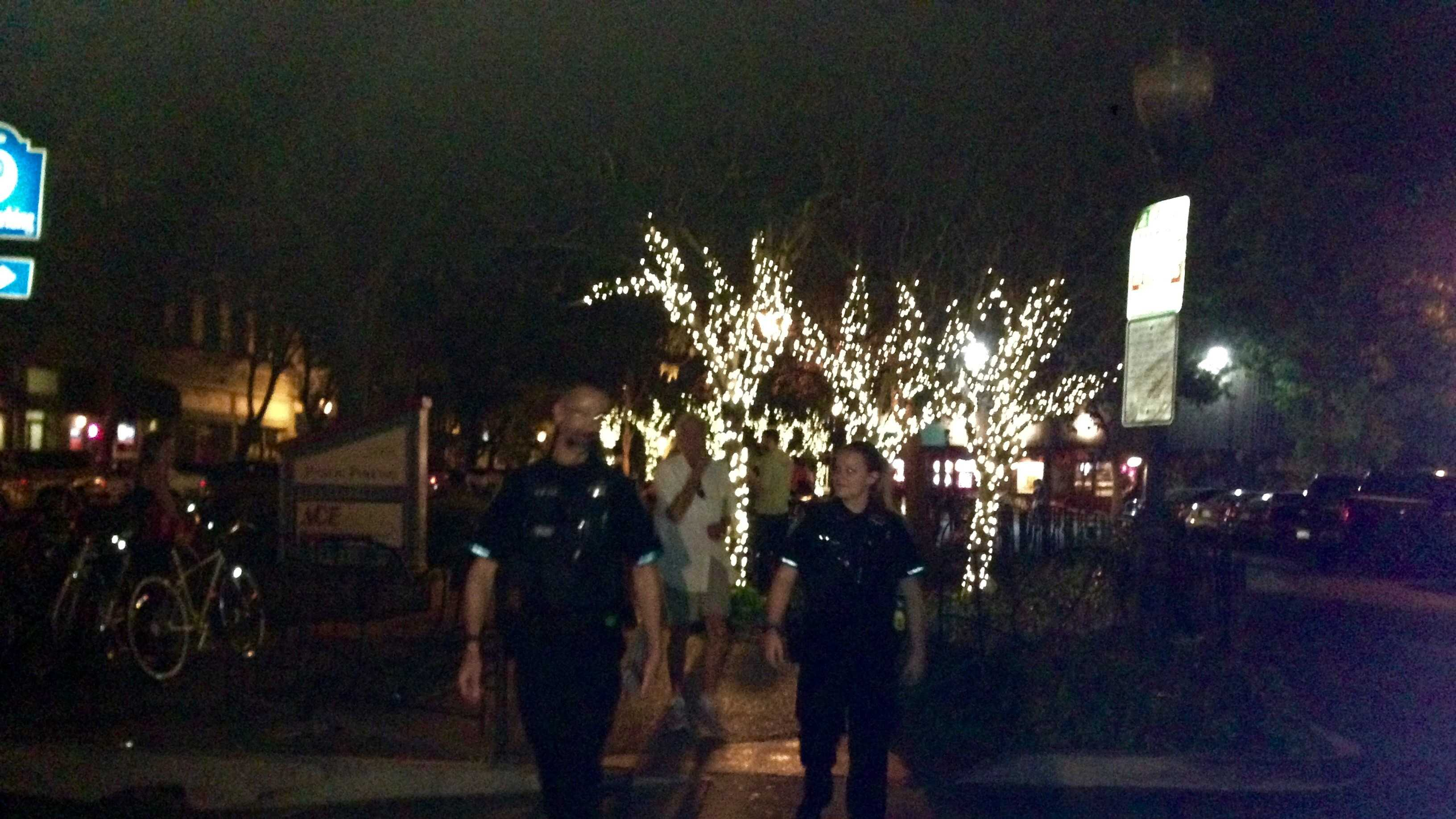 Two Davis police walk downtown on Friday, Oct. 2, 2015 in hopes to limit violence.
