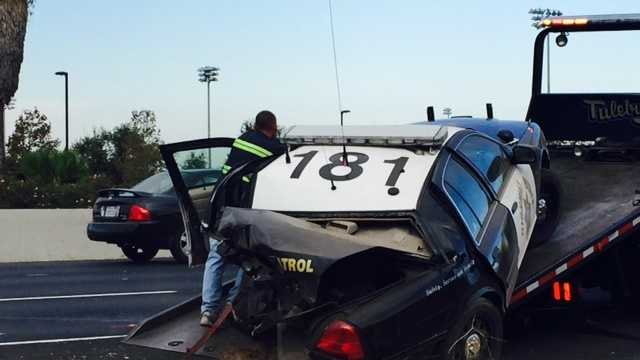 A Stockton CHP officer's car was on the side of Highway 99 at Morada Lane when it was struck by another vehicle Thursday. (Oct. 15, 2015)