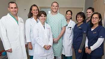 Airman Spencer Stone with his care team, from left to right: Associate Professor of Surgery Garth Utter, Nurse Practitioner Beth Maese, Fourth-Year Surgery Resident Eleanor Curtis, Nurse Practitioner Joyce Colobong, SICU Nurse Ruby Recta, Trauma Nurse Kaitlyn Morris and SICU Nurse Bernadette Beloy-Bachiller.