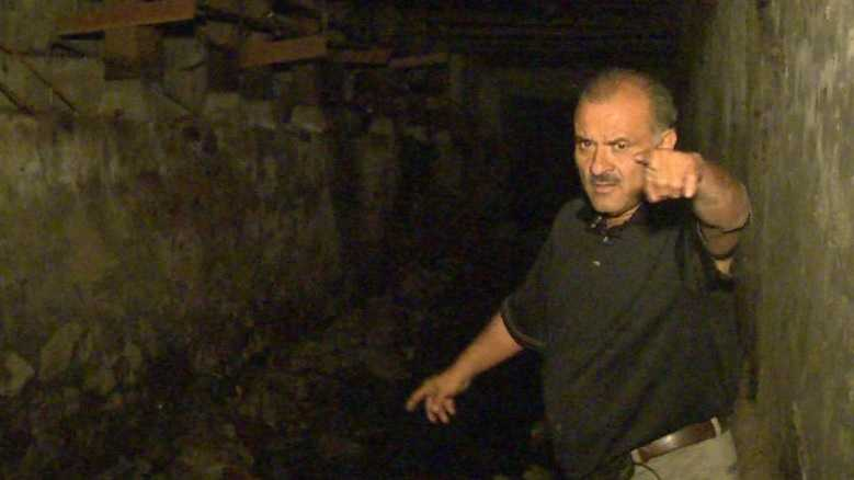 Auburn business owner Ruben Ramirez points out where he thinks two men were digging for gold in a storm drain under Old Town.