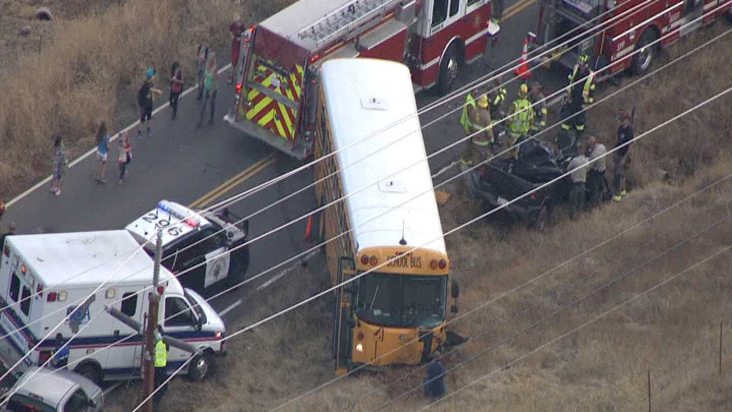 The California Highway Patrol investigates a fatal crash between a school bus and a vehicle on Thursday, Oct. 22, 2015.
