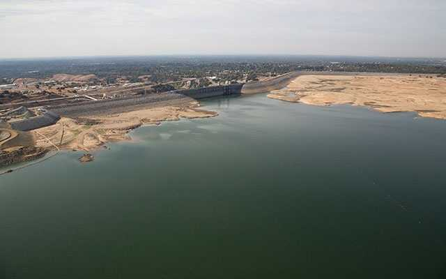 This aerial photo of Folsom Lake shows water storage at 30 percent of historical average, or 16 percent of total capacity, according to the California Department of Water Resources.