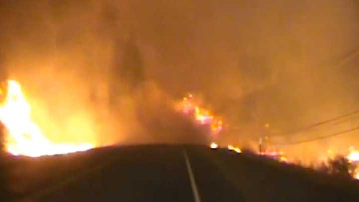 Dash camera video from Lake County sheriff's deputies shows flames and smoke from the Valley Fire crossing the roadway in front of the deputies' patrol car.