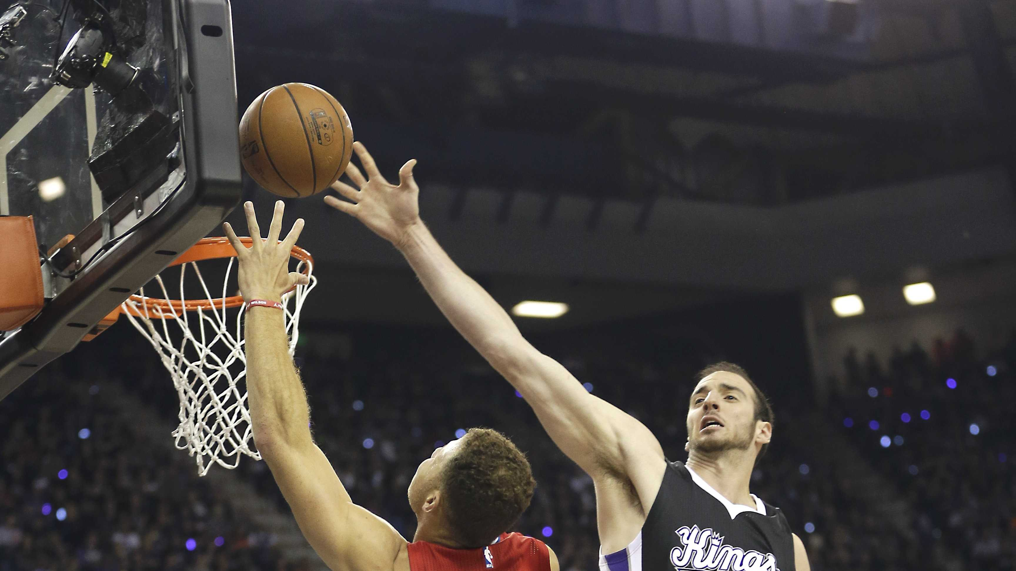 Los Angeles Clippers forward Blake Griffin, left, drives to the basket against Sacramento Kings center Kosta Koufos during the first quarter of an NBA basketball game in Sacramento, Calif., Wednesday, Oct. 28, 2015.