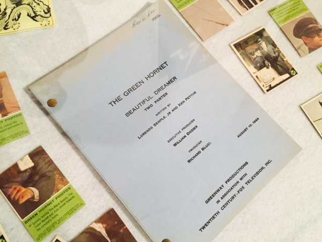 "Bruce Lee's final ""Green Hornet"" script is on display alongside pictures of the famous actor and martial artist."