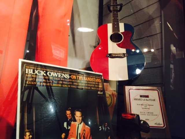 Country music star Buck Owen's signature red, white and blue guitar is on display at the California Museum.
