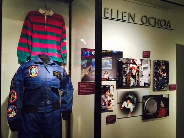 Astronaut Ellen Ochoa's space suit sit in the museum alongside a moon rock insured for billions of dollars.