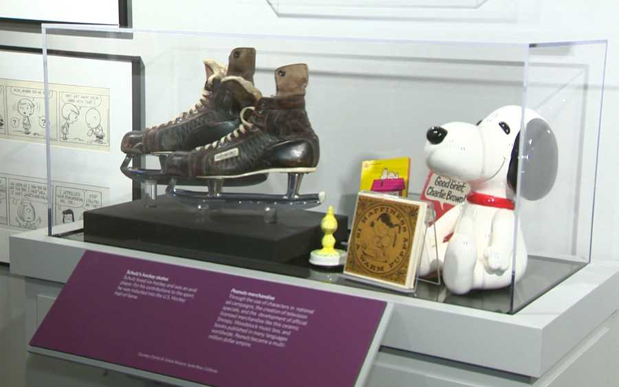 "Speaking of ice skating, Charles M. Schultz was a lover of the ice and especially ice hockey. His family donated his well-used ice skates, which sit next to some classic ""Peanuts"" items."