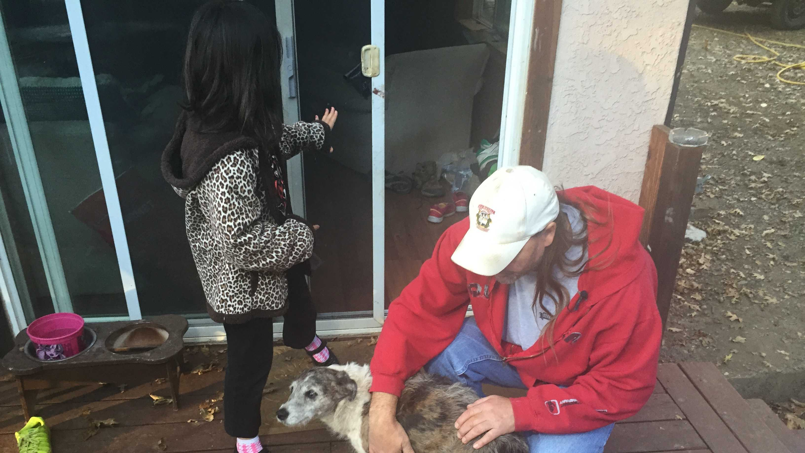Kirk Fetter pets his dog Tiki on Thursday, Oct. 29, 2015, the day after Tiki was attacked.