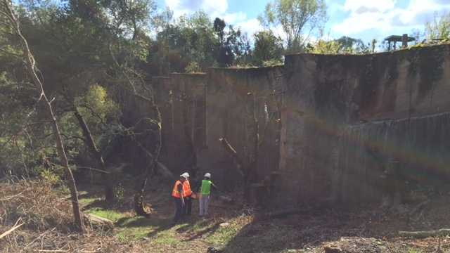 State officials inspect the tailings dam at the former Argonaut Mine in Jackson.