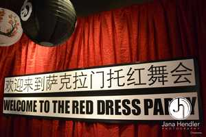 """Sign at that hung at the Sacramento Red Dress event. Sacramento Asian Pacific Islander groups spoke out against the """"Red Dragon"""" theme, calling it offensive. (PHOTO: Jana Hendler Photography)"""