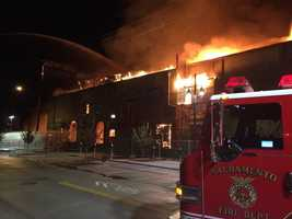 A three-alarm fire that broke out Saturday morning ripped through a vacant, historic building at R and 16th streets in downtown Sacramento. (Nov. 7, 2015)
