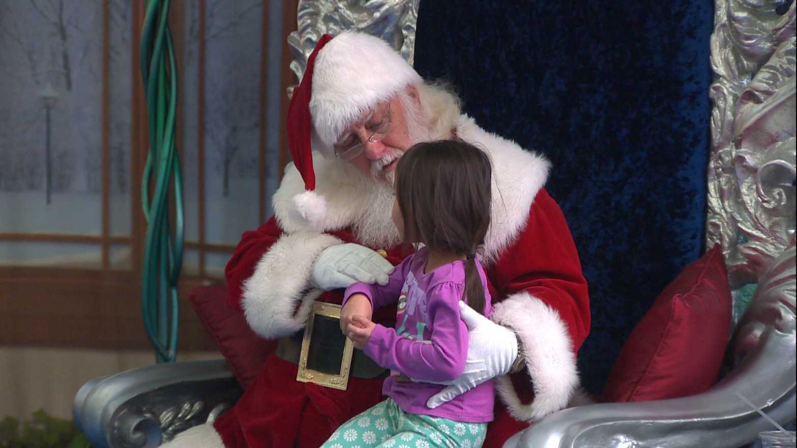 Santa talks to a little girl at Arden Fair Mall on Wednesday, Nov. 11, 2015.