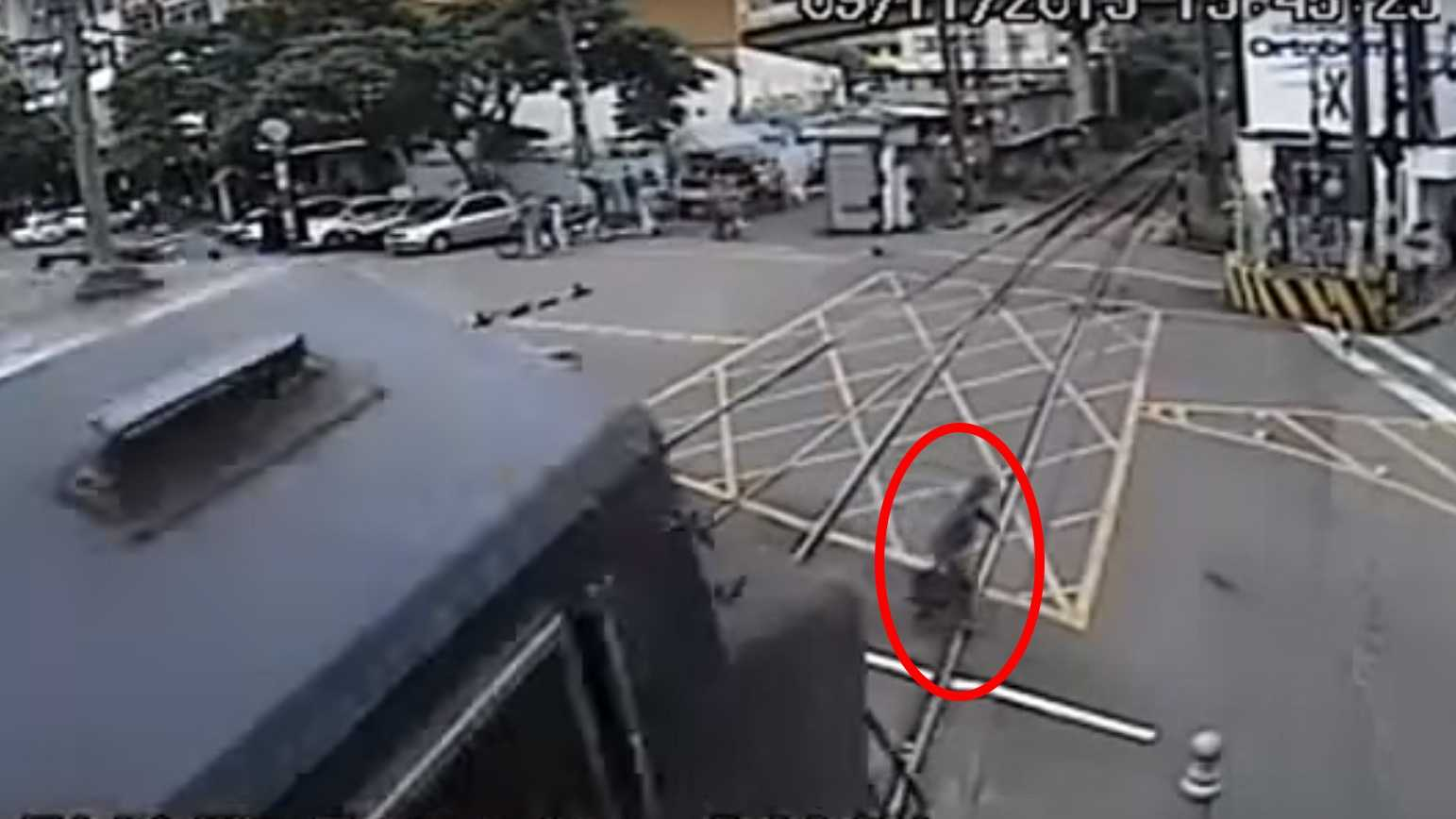 Elderly man seen on surveillance camera nearly gets hit by train in Brazil. Photo is a screen grab of the video.