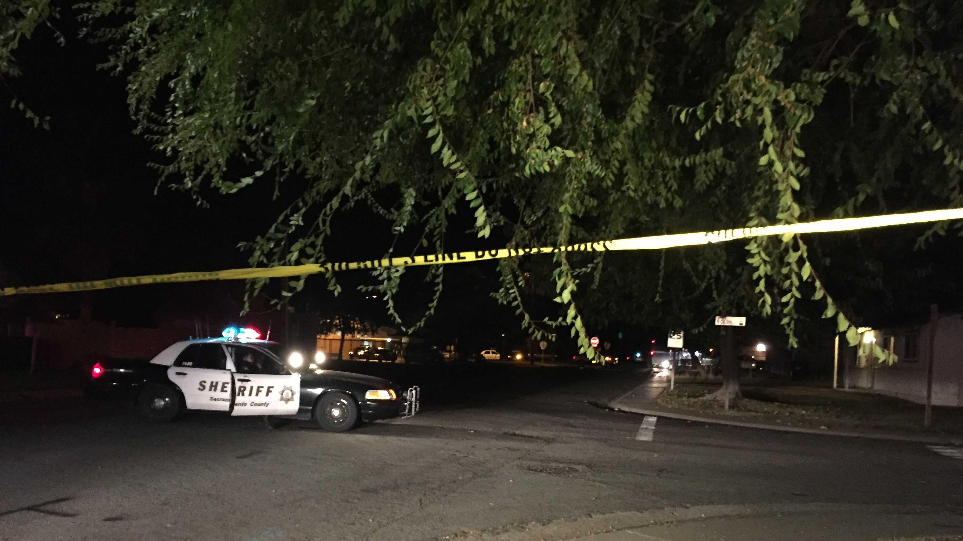 Sacramento County sheriff's deputies search for a man who shot at a father and son in a Rio Linda neighborhood on Thursday, Nov. 12, 2015.