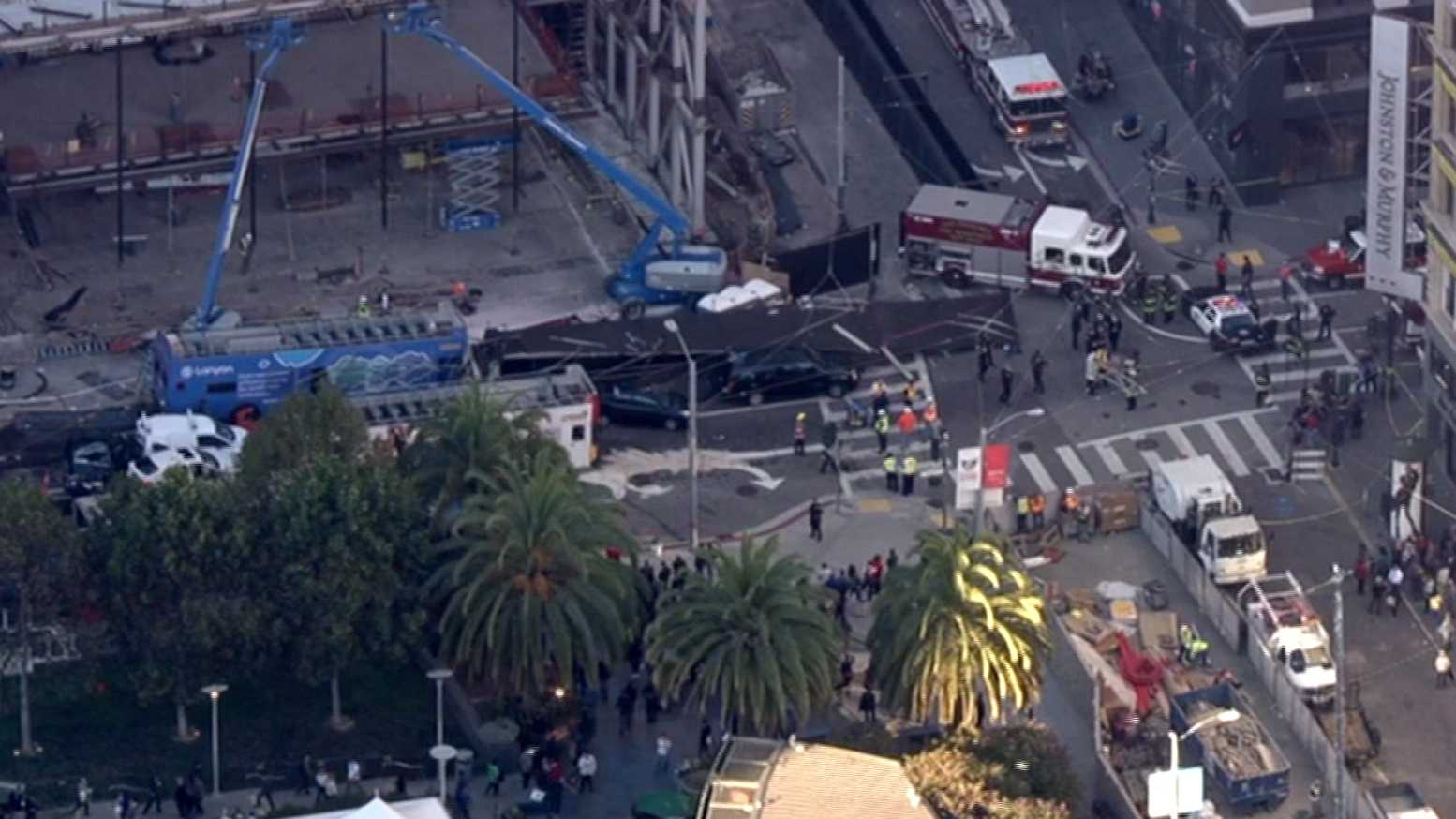 A tour bus crashed Friday, Nov. 13, 2015, at the intersection of Stockton and Post at Union Square in San Francisco.
