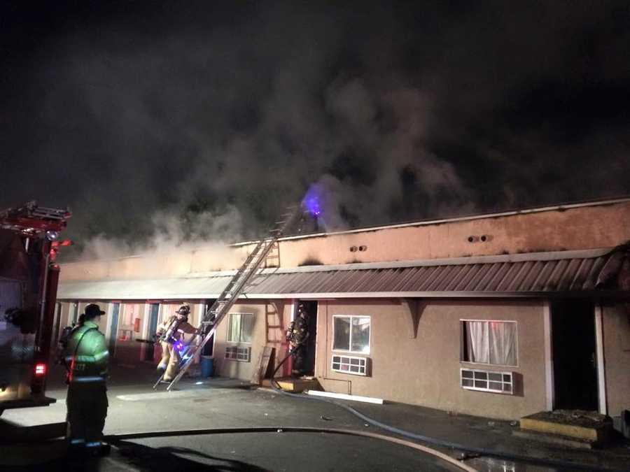 Crews fight a fire at a Modesto hotel on Saturday, Nov. 14, 2015.