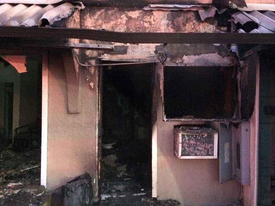 Crews extinguish a fire at a Modesto hotel on Saturday, Nov. 14, 2015.