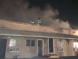 Crews fight a fire at a Modesto hotel on Saturday, Nov. 14, 2015.