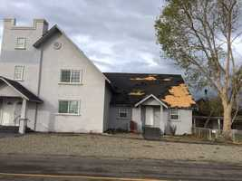 A funnel cloud that moved through Denair on Sunday, Nov. 15, 2015 a church's roof as it moved east out of the city, the Stanislaus Sheriff's Department said.