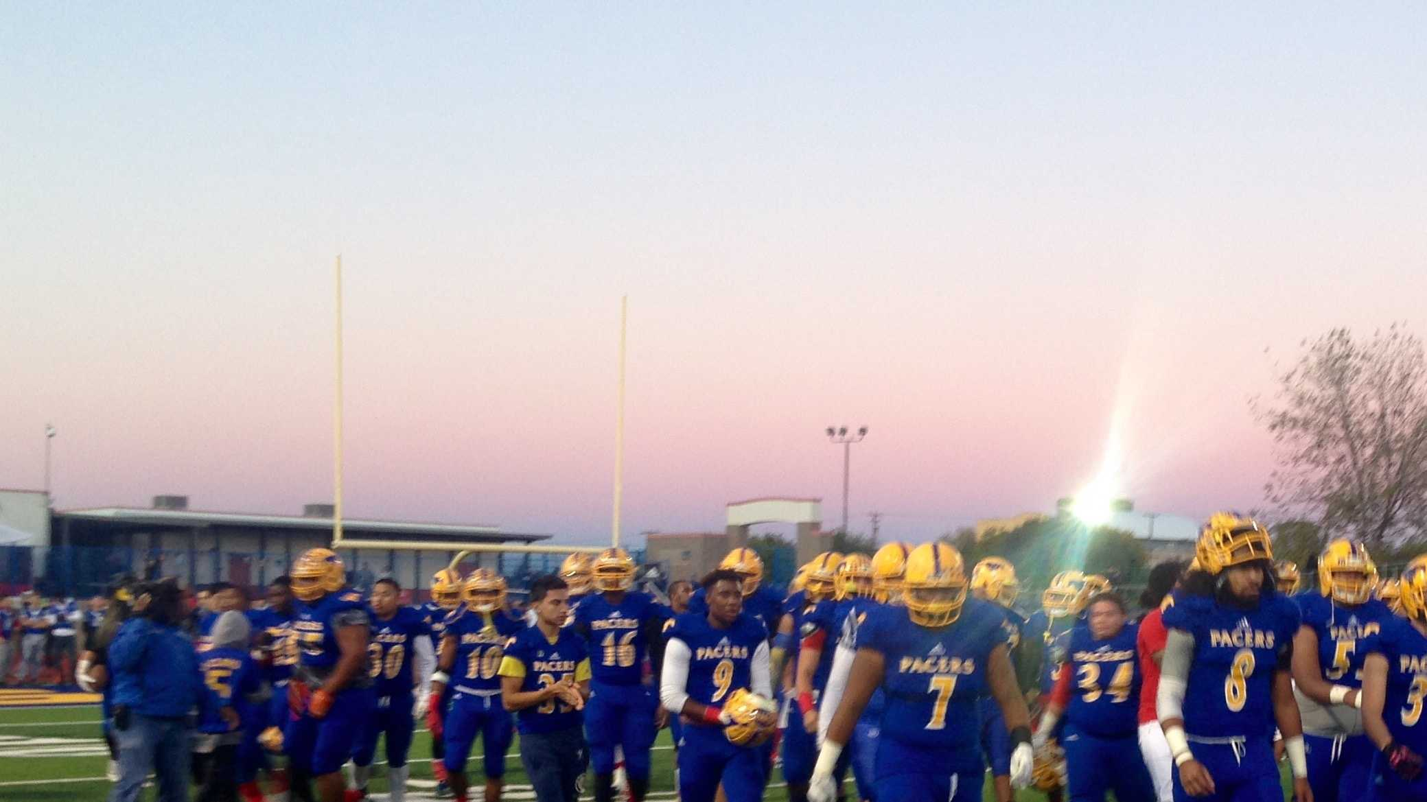 Monday night was an emotional return to the football field for the Grant Union High School Pacers, as the school mourned the loss of one of its students who was shot and killed Friday night.