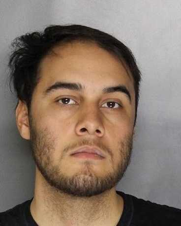 Nicholas Rivera, 21, is accused of robbing a credit union on Arena Boulevard, Sacramento police said.