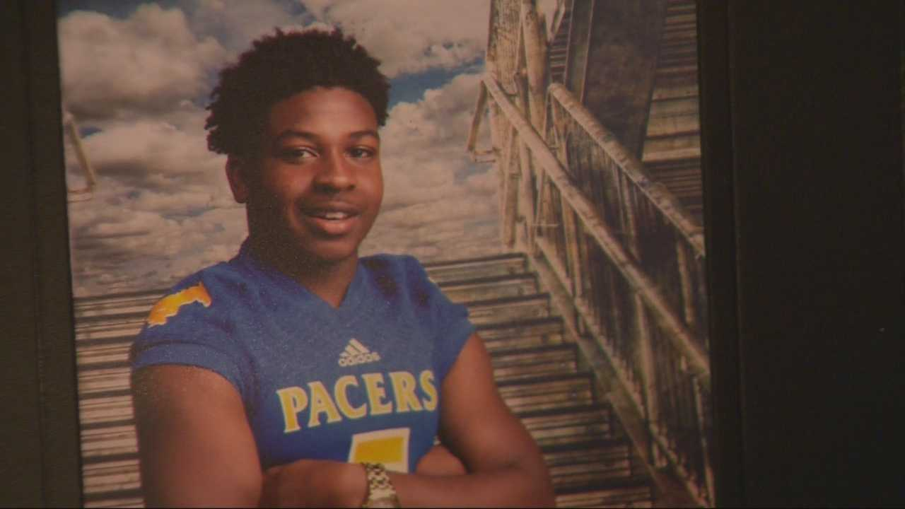 Dozens of people gathered Friday night to pay their respects at a viewing for a high school football player shot and killed before a playoff game two weeks ago.