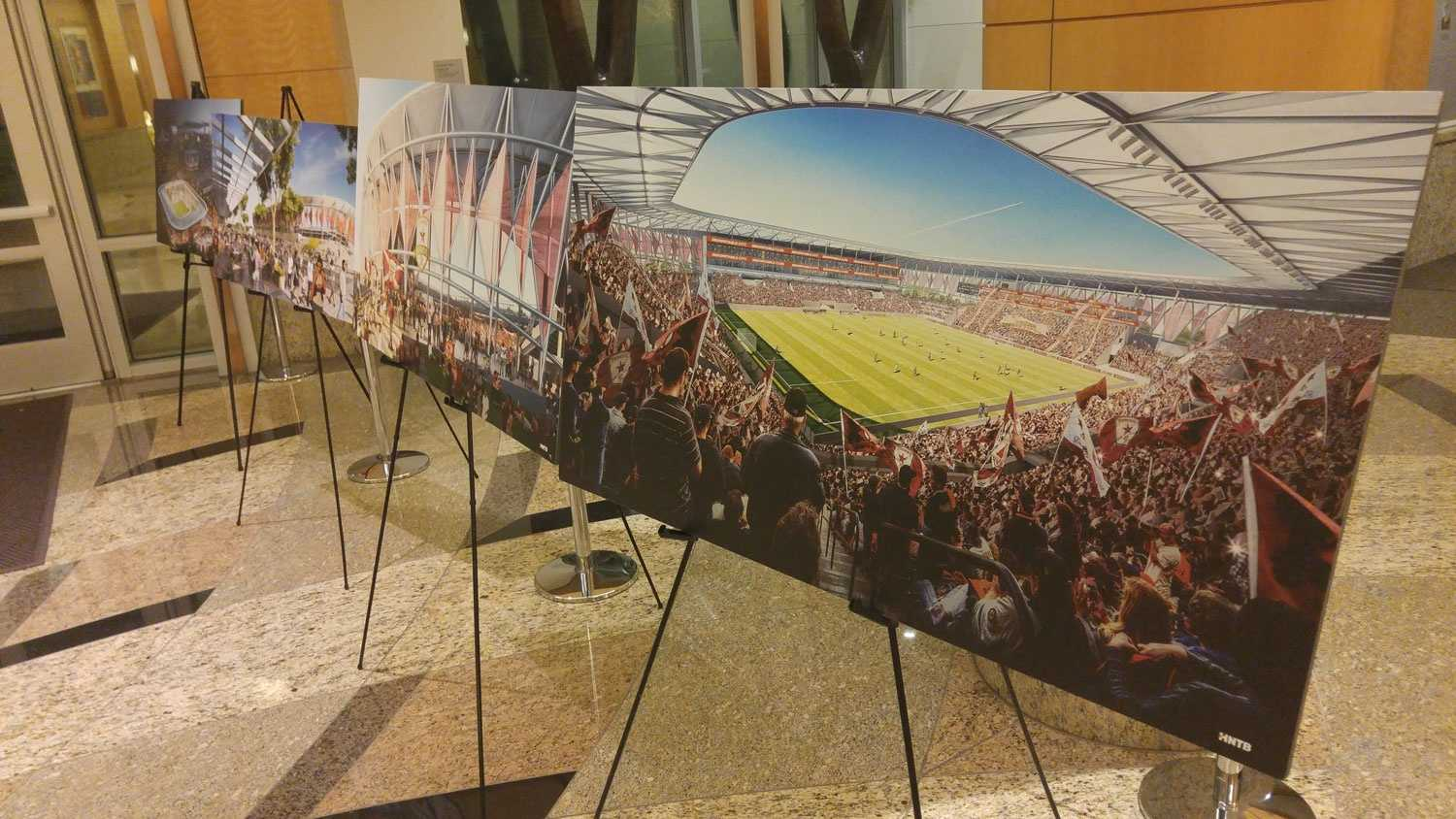 Renderings of a soccer stadium proposed to be built at the downtown Sacramento railyards were displayed on Tuesday, Dec. 1, 2015, at city hall. City council members voted to approve a term sheet for the stadium during its meeting that night.