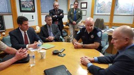 California Gov. Jerry Brown and California Office of Emergency Services Director Mark Ghilarduccui get briefed on Thursday, Dec. 3, 2015, by San Bernardino Police Chief Jarrod Burguan, the FBI and others on the investigation into the mass shooting.