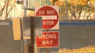 """Do Not Enter"" sign stands at an exit ramp to warn drivers not to go on the ramp to enter the highway."