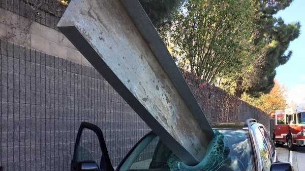 A metal tray crashed through the windshield of a car Friday, Dec. 11, 2015, on Interstate 280 near San Jose, the fire department said.