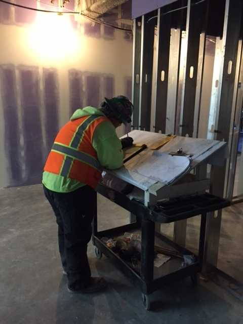 Construction workers continue to build and design the Golden 1 Center on the inside and out.