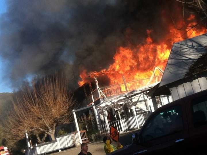 Flames engulf the second floor of the Sierra Nevada House on Monday, Dec. 14, 2015.