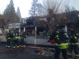 Cal Fire fighters work to completely contain a blaze at the historic Sierra Nevada House on Monday, Dec. 14, 2015. When crews first arrived, flames could be seen coming out of the second floor.