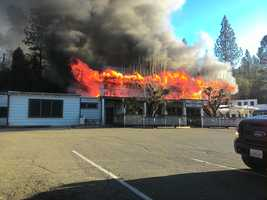 Black smoke and large flames engulf the second floor of the Sierra Nevada House on Monday, Dec. 14, 2015.
