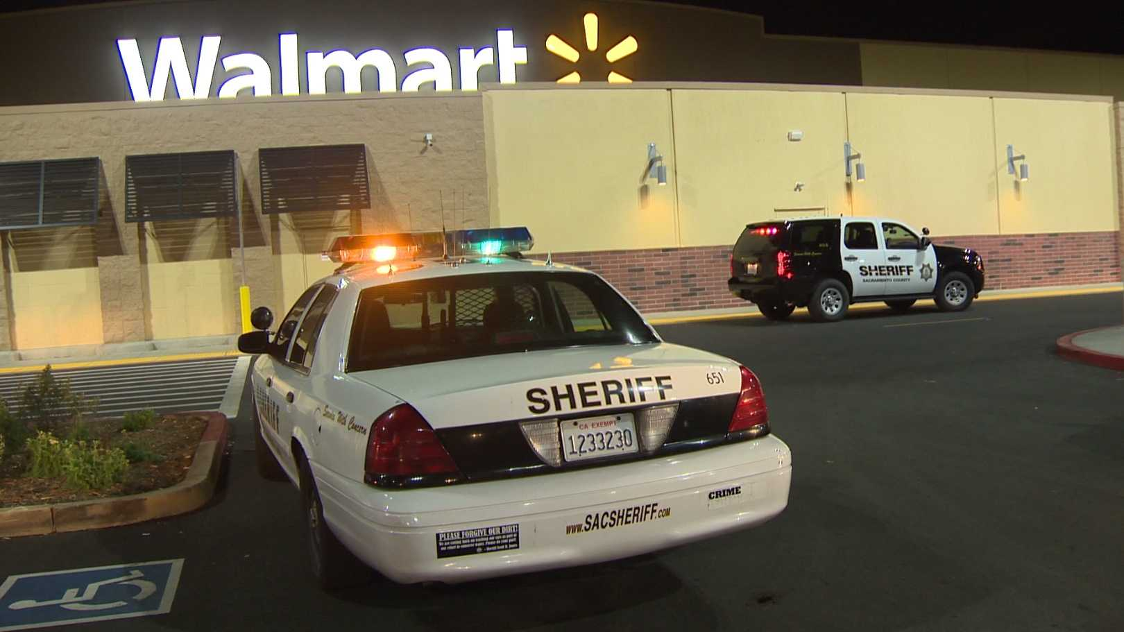 The Sacramento County Sheriff's Department investigates a flare gun shooting at a south Sacramento Walmart on Monday, Dec. 14, 2015.
