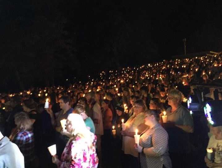 Hundreds of people showed up for a candlelight vigil to honor the victims killed in the UCC shooting.