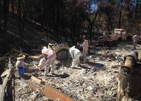 Crews worked to sift through hazardous materials that were left by homes destroyed in the Butte Fire.