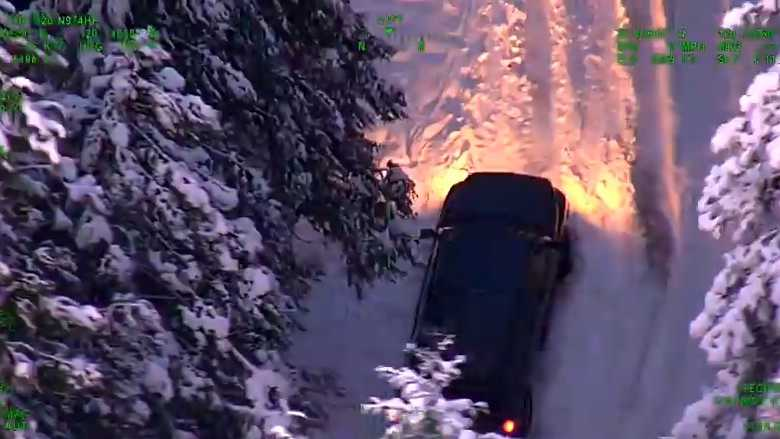 Video from a California Highway Patrol helicopter shows a truck stuck in the snow near Washington, Calif. on Monday, Dec. 14, 2015.