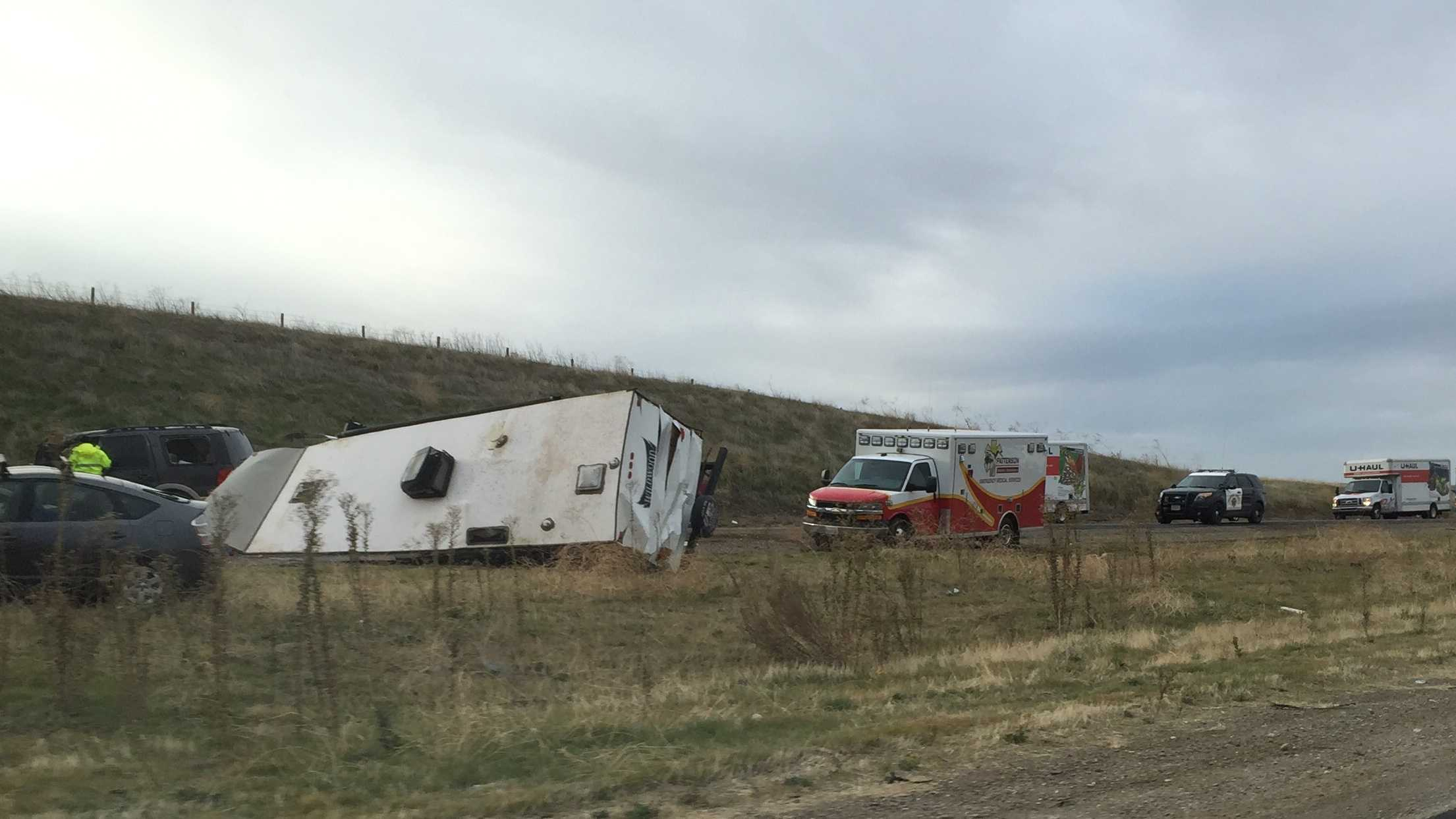 CHP and paramedics at the scene of an overturned RV on I-5 near Patterson Sunday. (Dec. 20, 2015)
