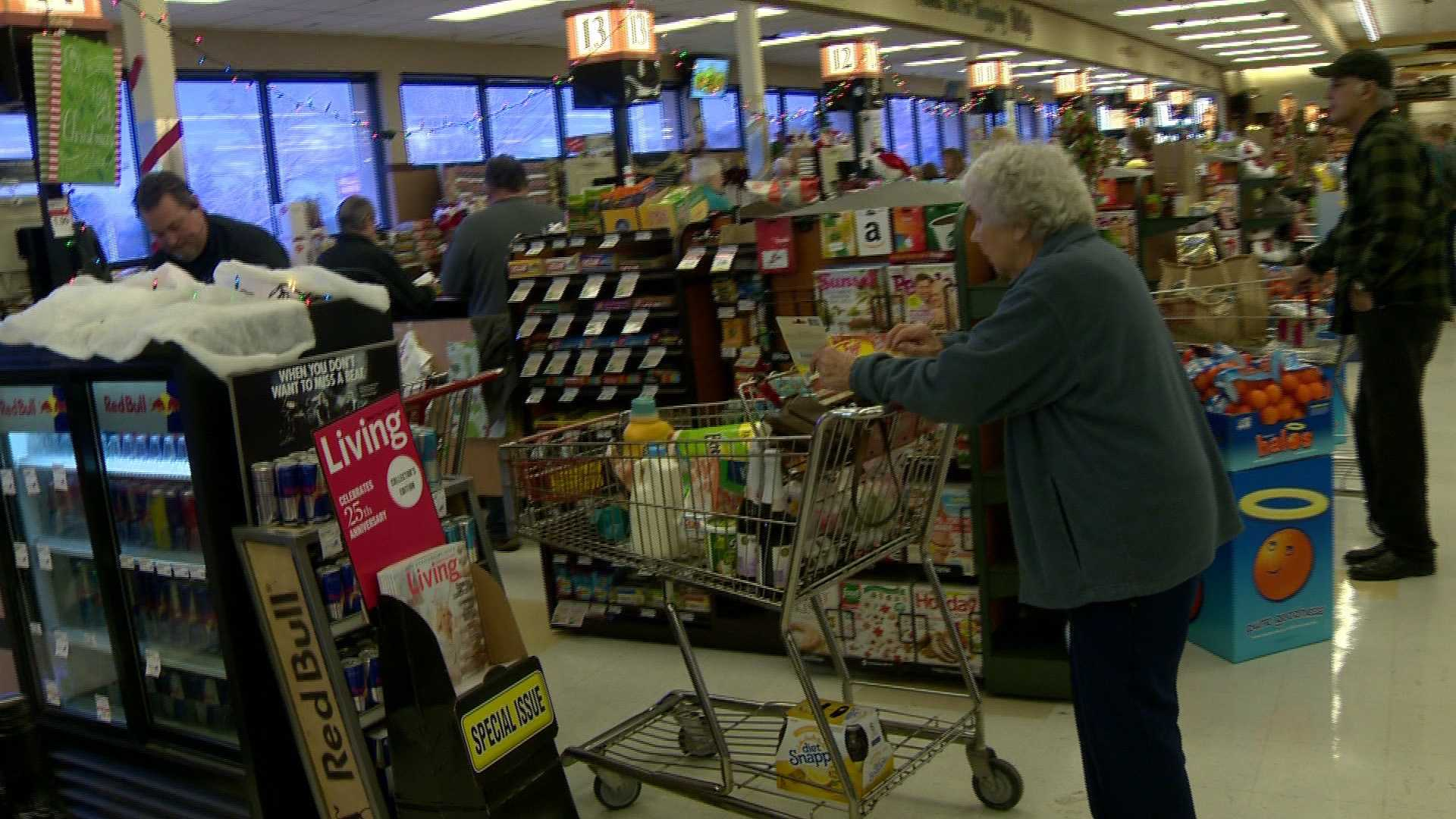 Customers stock up on Christmas and storms supplies at the Raley's supermarket in Placerville.