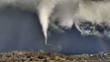 A tornado touched down in El Dorado County on Thursday, Dec. 24, 2015, around 3 p.m. The National Weather Service issued a warning for El Dorado and Amador counties until 4:30 p.m. that day. KCRA viewers shared photos of the funnel cloud, tornado and the damage when the storm moved over the area.