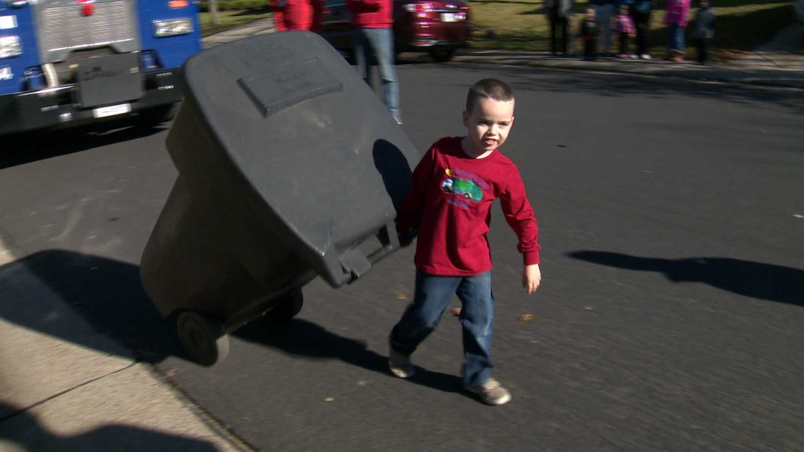Jobiah Wells, 4, moves a trash can in his Folsom neighborhood on Friday, Dec. 25, 2015. The boy asked for four new trash bins for Christmas, and the city of Folsom stepped up to grant his wish.