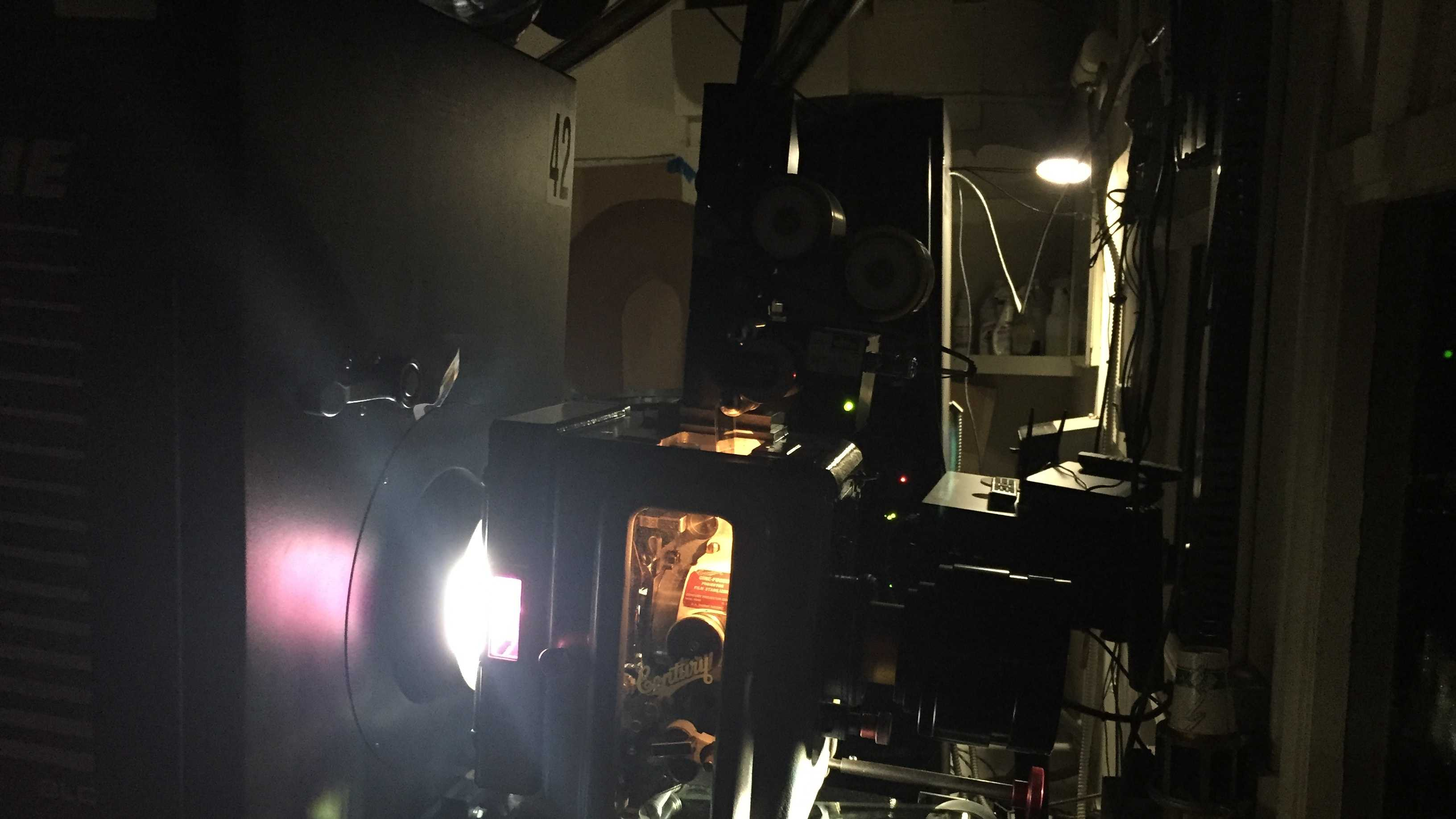 "A side view of the 70 mm film projector at Sacramento's Tower Theater shows how light goes through the film from the left and the movie projects onto the screen from right. Tower Theater is one of 100 theaters in the country showing Quentin Tarantino's latest movie, ""The Hateful Eight,"" in 70 mm film."