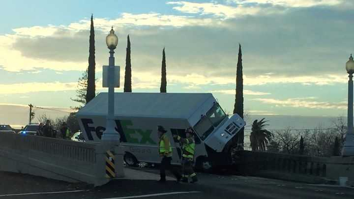 A crash involving a FedEx truck and a vehicle is blocking the Sierra Street Bridge in Roseville on Friday.